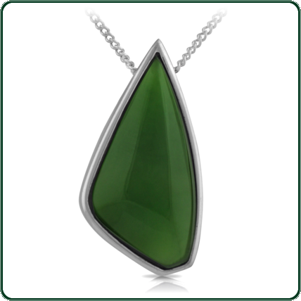 Popular, asymmetrically carved green Jade pendant mounted in silver.