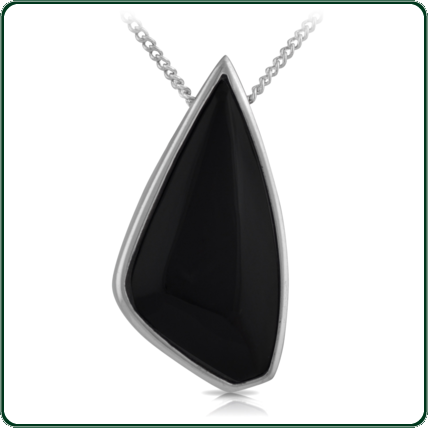Popular, asymmetrically carved black Jade pendant mounted in silver.