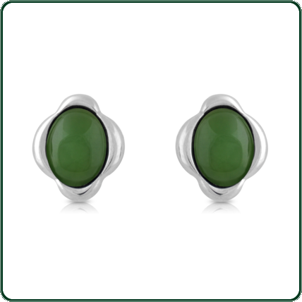 Floral inspired silver setting around green oval-cut Jade.