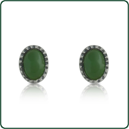 A finely detailed and delicate stud setting capturing oval-cut green Jade.