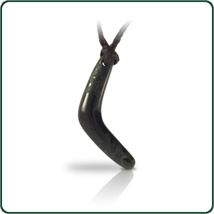 Finely carved Jade boomerang in black Nephrite Jade featuring subtle decorative motif.