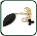 Delicate carved Jade leaf pendant in black Nephrite Jade featuring fine gold lacing.