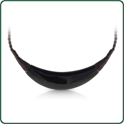 Crescent pendant carved from black Jade with traditionally inspired detailing leading to the plaited lacing.