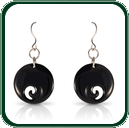 Carved black Jade disc earrings featuring a style based on traditional New Zealand designs.