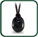 Simple yet elegant carved black Jade pendant, loop-fixed with plaited lacing.