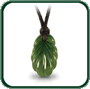 Based on traditional plant motif, this pendant is finely carved in green Nephrite Jade.