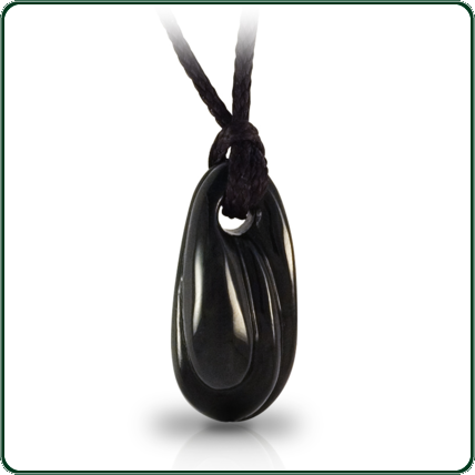 Subtly carved black Jade pendant reflecting the smooth, organic lines of nature.