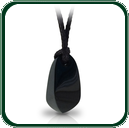Evoking a touch of the primitive, this Australian dark Jade pendant is striking in its simplicity.