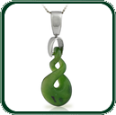Intricately carved Jade pendant reflecting traditional twist design of the Pacific, featuring silver ring and bale.