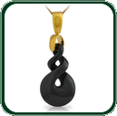 Eye-catching carved twist pendant in black Nephrite Jade on gold bale and chain.