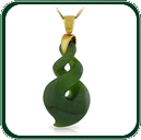 Featuring a gold or silver bale and chain, this carved green Jade pendant is a contemporary interpretation of an ancient twist design.
