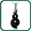 Featuring a gold or silver bale and chain, this carved black Jade pendant is a contemporary interpretation of an ancient twist design.