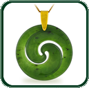 Based on the New Zealand Koru design, this carved pendant is available in green Jade and features gold bale and necklet.
