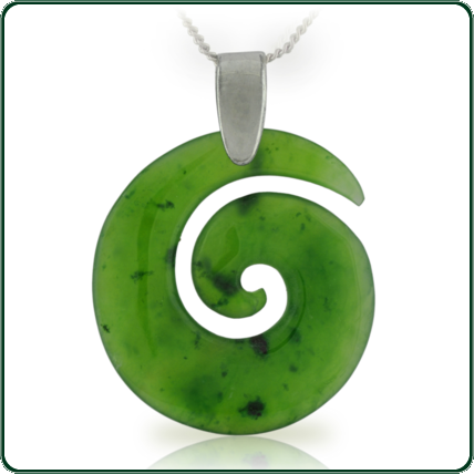 Simple spiral coil pendant delicately carved from green Jade and enhanced with a fine silver necklace.
