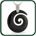 Simple spiral coil pendant delicately carved from dark Jade and enhanced with a fine silver necklace.