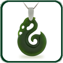 Distinctive seahorse amulet pendant in green Jade beneath a silver bale and necklace.