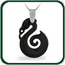 Distinctive seahorse amulet pendant in black Jade beneath a silver bale and necklace.