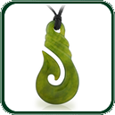 Traditional style fish hook design pendant carved in fine green Jade and featuring a plaited twine lacing.