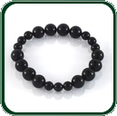 The large and small perfectly carved black Jade beads make this bracelet as captivating as it is elegant - perfect for daywear or teamed with a chic evening gown. Consists of 12 beads 10mm and 9 beads 7mm.