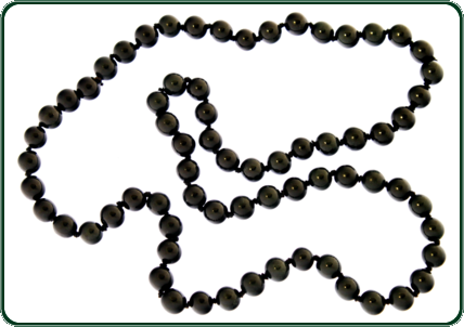 "Reminiscent of a string of luxurious black Jade ""pearls"", the carefully carved beads of this striking necklace evoke an aura of timeless sophistication. Pair this necklace with one of Australian Jade's pearl-style bracelets for a truly dramatic effect."