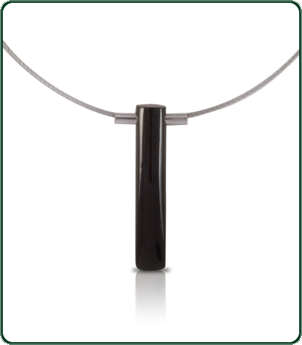 The single, lustrous black Jade rod is strikingly elegant and the perfect accessory with evening-wear.