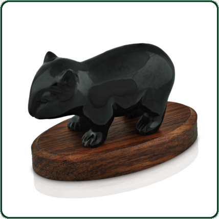 The shy, elusive wombat is beautifully represented in this silky black Jade figurine.