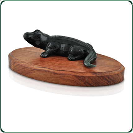 There is almost a smile on the face of this finely carved crocodile in black Jade with a subtle dark green tint.