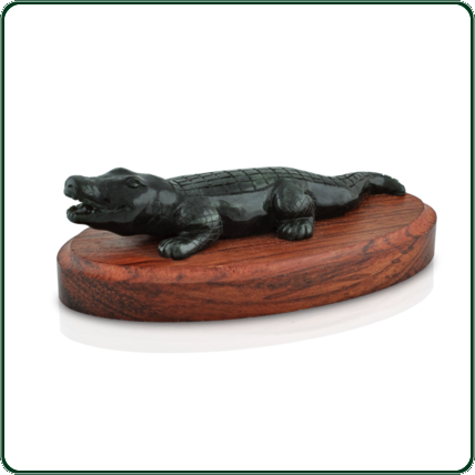 The uniqueness of dark green hues of the jade captures the uncommon beauty of this feared predator.