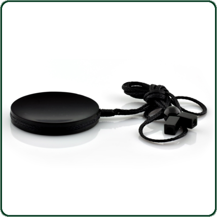 Dramatic black jade disc pendant with a slight gloss finish for extra distinction, hanging from plaited cotton thread.