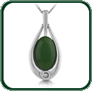 Green, oval-cut Jade pendant mounted in finely detailed silver teardrop setting.