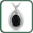 Oval-cut dark Jade within a silver setting inspired by the traditions of the South Pacific.