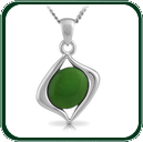 Oval of green Jade mounted in an asymmetrical silver pendant setting.